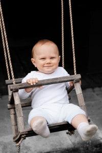 baby_boy_on_a_swing_207772